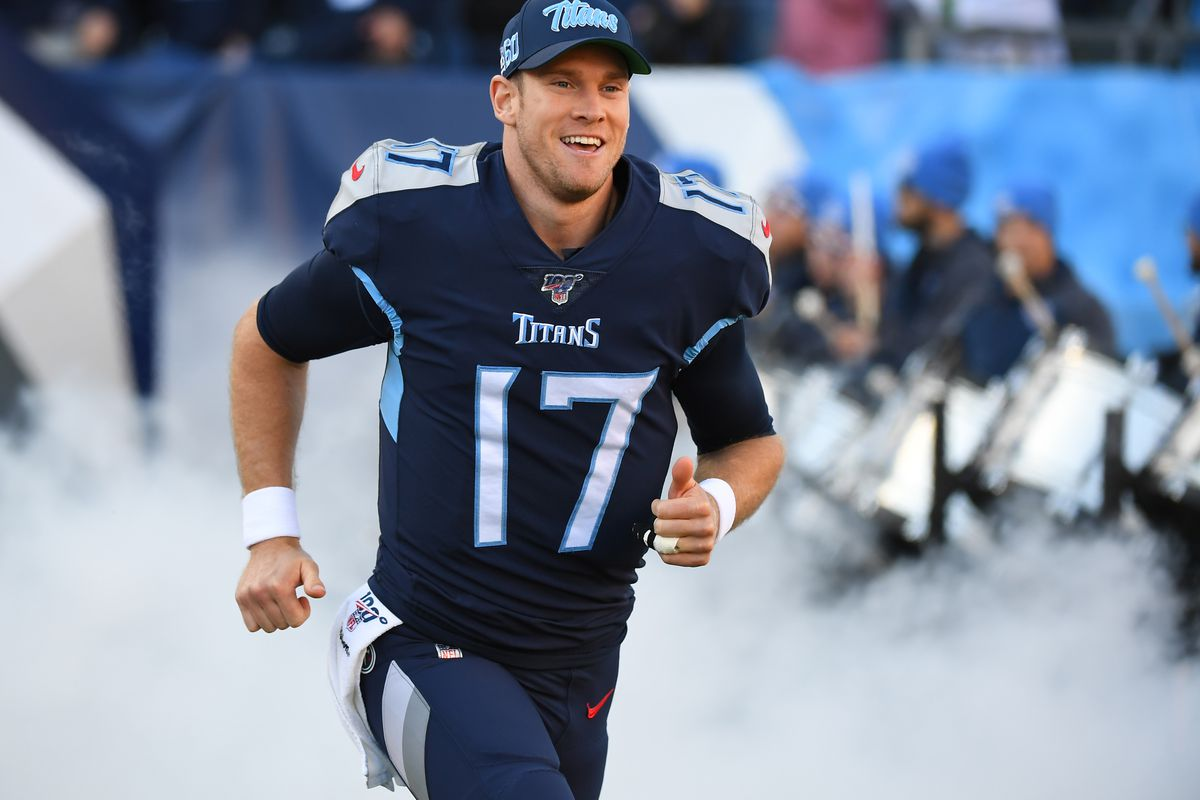 Tennessee Titans quarterback Ryan Tannehill takes the field during player introductions before the game against the Jacksonville Jaguars at Nissan Stadium.