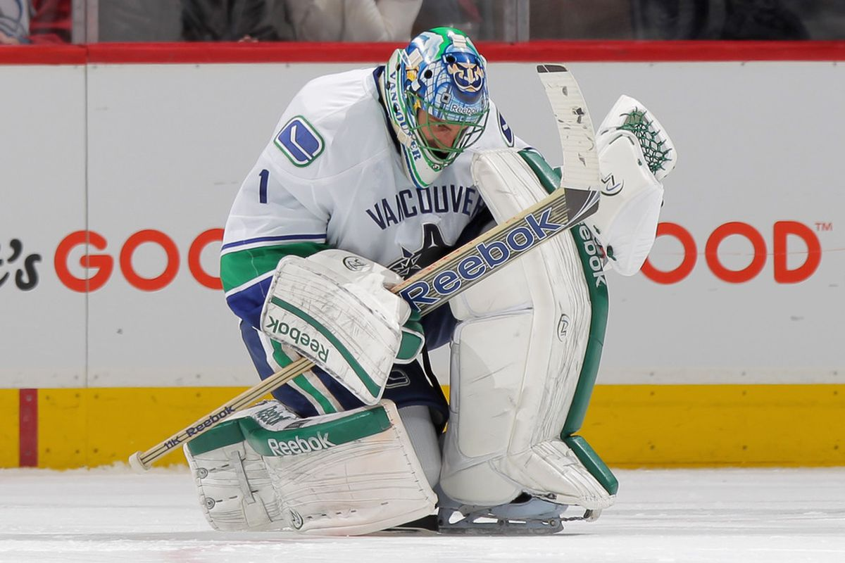 DENVER, CO - FEBRUARY 04:  Roberto Luongo #1 of the Vancouver Canucks Tebows after making the game winning save in a shoot out against Ryan O'Reilly #37 of the Colorado Avalanche at the Pepsi Center on February 4, 2012 in Denver, Colorado.