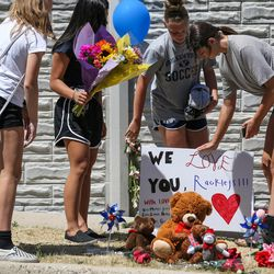Kate Munger, Jessey Fournier, Sophie Fry and Sydney Schmidt, all 14, place flowers, stuffed animals and a sign at a memorial to the victims of Tuesday's fatal shooting on Alta Canyon Drive in Sandy on Wednesday, June 7, 2017.