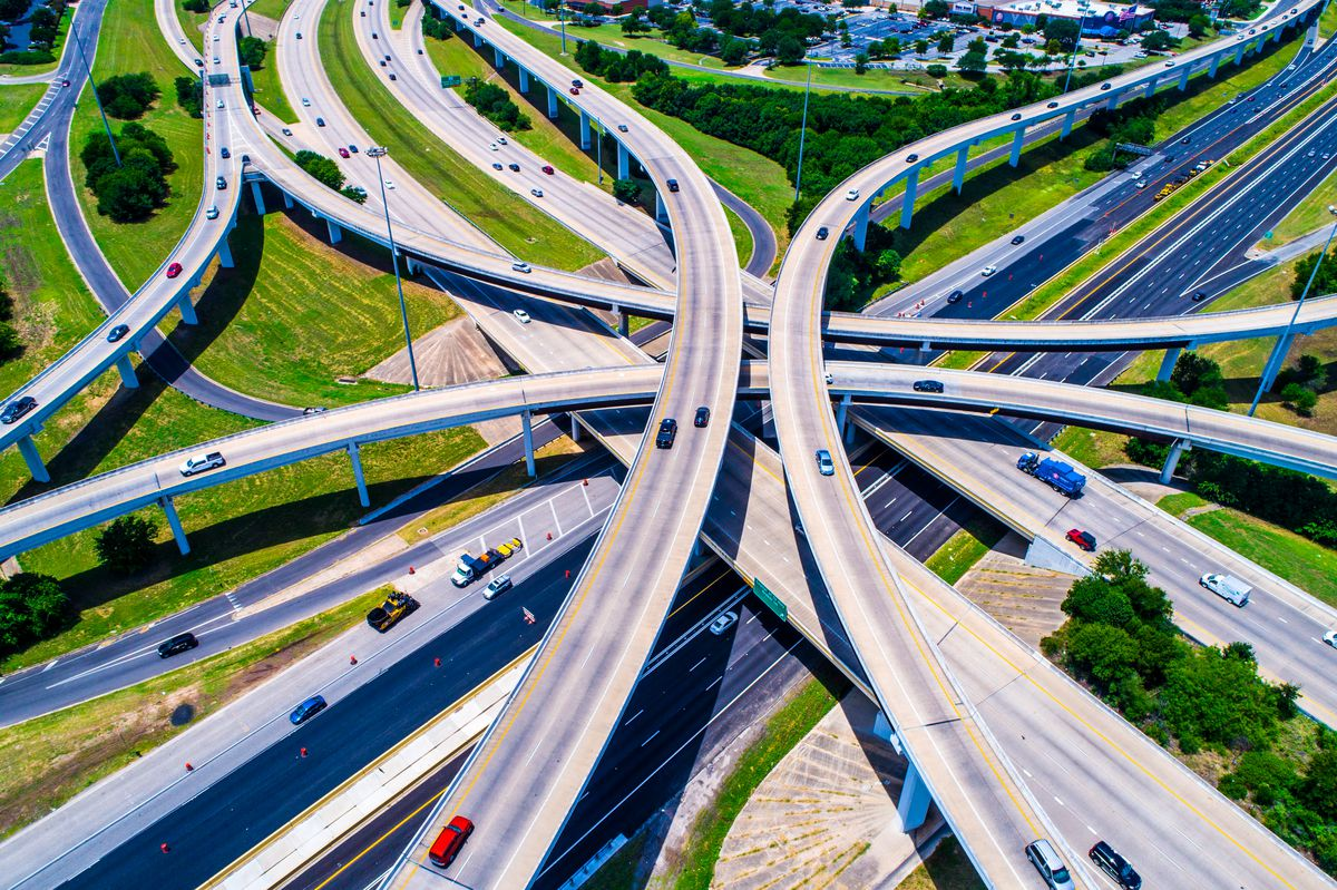 An aerial photo of a lot of highways crisscrossing one another.