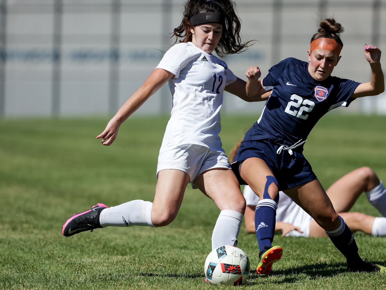Skyline's Rozlin Gomez and Brighton's Eliza Hobby vie for control of the ball in a girls soccer game in Cottonwood Heights on Tuesday, Sept. 1, 2020.