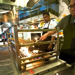 Chefs cooking on the 600-degree robata grill