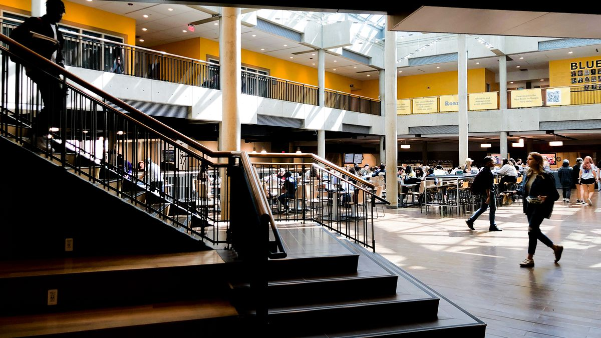 Students walking down and near the stairs at the Brower Student Center at the College of New Jersey.