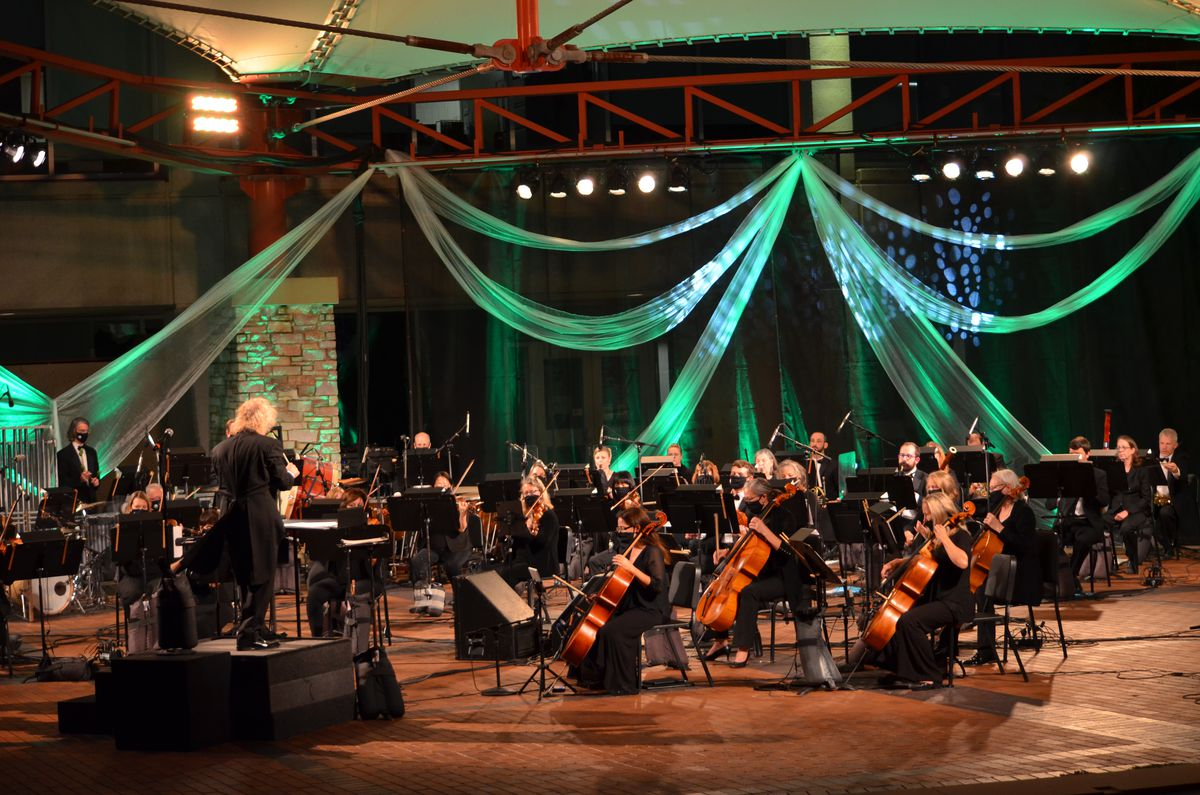 The New Philharmonic performs outdoors for a filmed concert at the McAninch Arts Center Lakeside Pavilion.