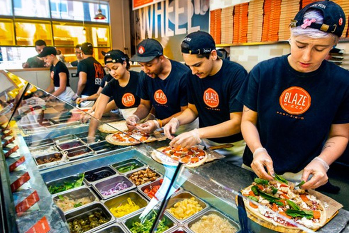 Employees at a Blaze Pizza location