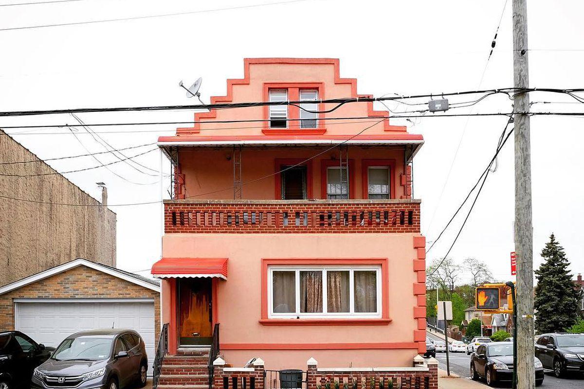 light orange sherbet-hued house