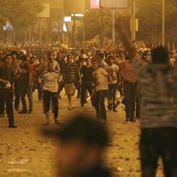 Egyptians clash early Sunday, April 29, 2012 in Cairo, Egypt. Security officials say a protester has been killed when clashes erupted between unidentified assailants and demonstrators gathered outside the Defense Ministry in the Egyptian capital to call for an end to military rule.