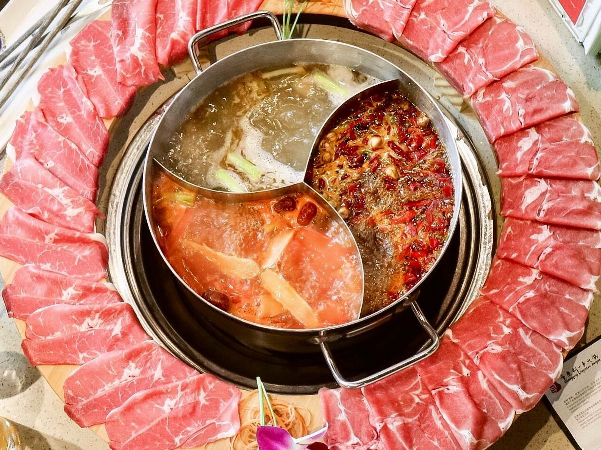 Three-section hot pot surrounded by a ring of sliced beef at Liuyishou Hot Pot on Convoy Street