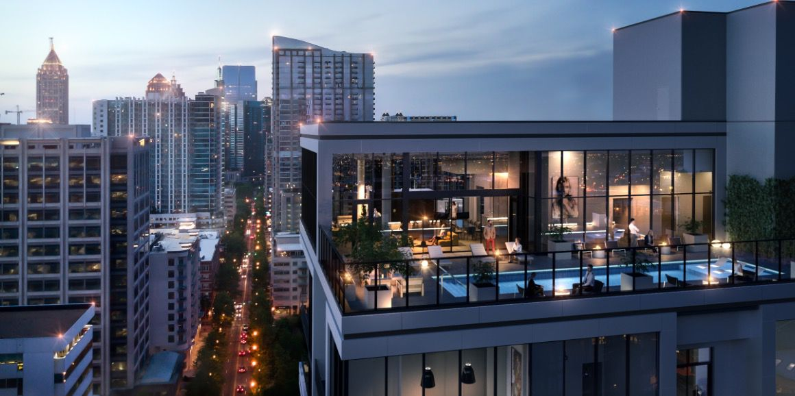A two-story glassed-in lounge and pool on top of the high-rise.