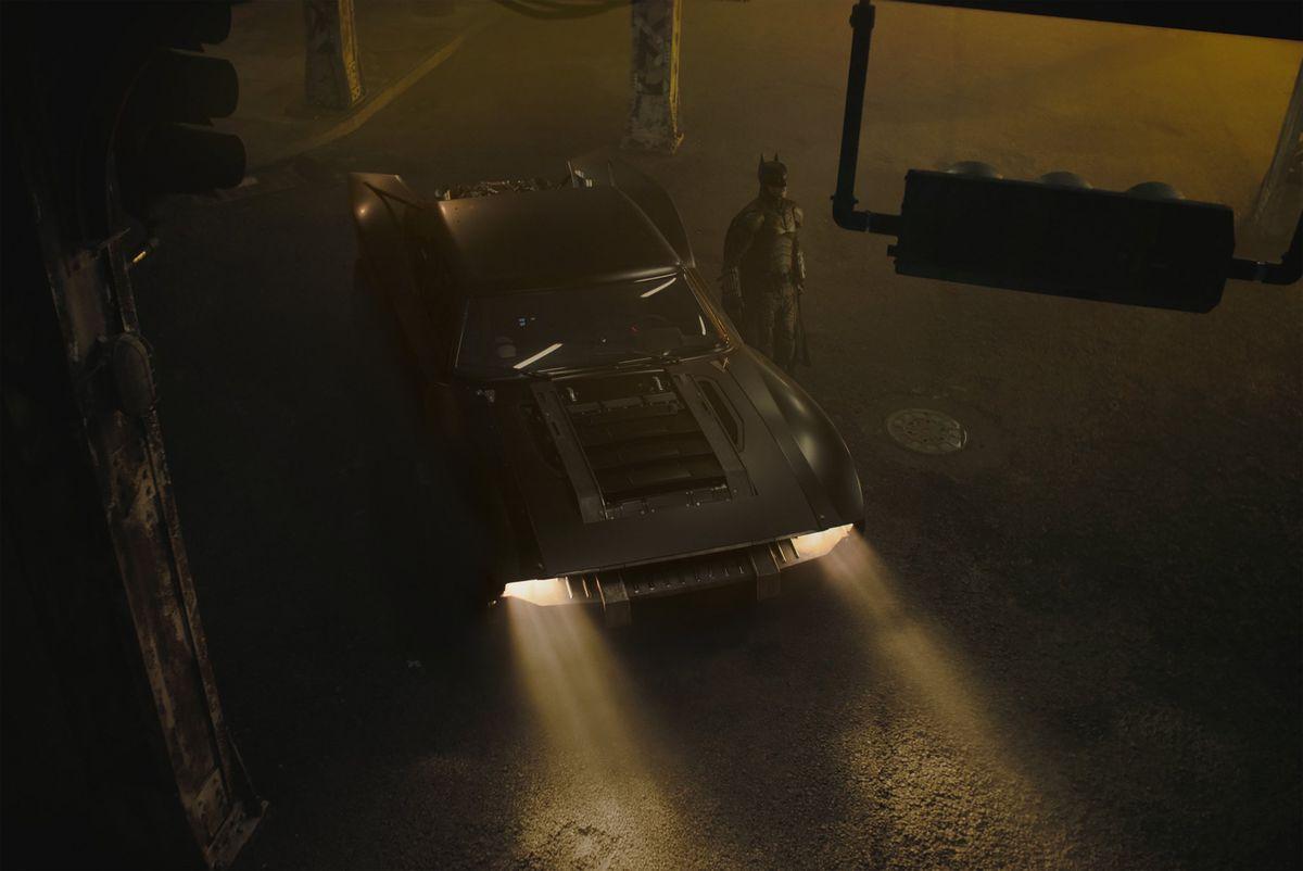 A top-down photo of the new Batmobile and Batman from Matt Reeves' The Batman (2021)