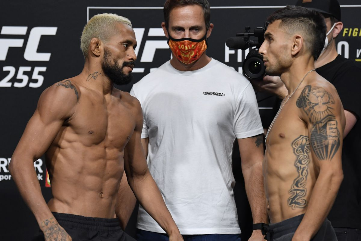 Opponents Deiveson Figueiredo of Brazil and Alex Perez face off during the UFC 255 weigh-in at UFC APEX on November 20, 2020 in Las Vegas, Nevada.
