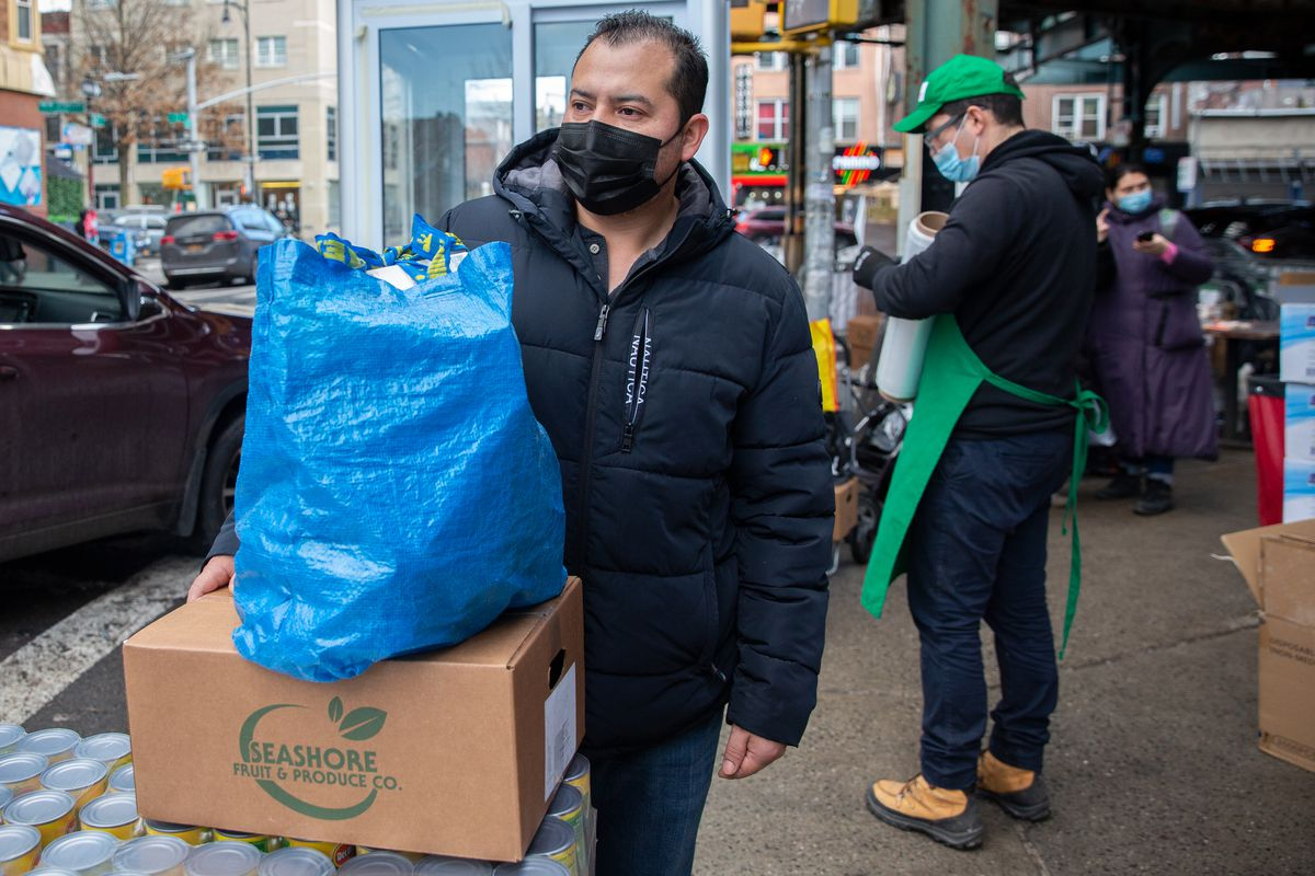 Sunset Park resident Marcelino Cabrera picks up food for his family at the Masbia pantry in Borough Park.