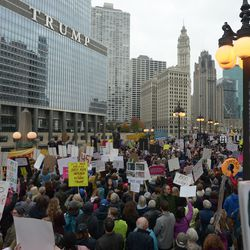 Protesters rally across the river from Trump International Hotel and Tower in Chicago on Monday, October 28, 2019.