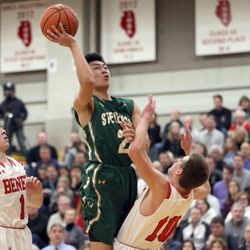 Stevenson's Luke Chieng (2) is called for the charge on Benet Academy's Trevor Casmere (10) in their 63-59 loss in Lisle, Saturday, February 16, 2019.   Kevin Tanaka/For the Sun Times