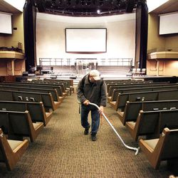 John Petrovich vacuums at the Life Center Church Sanctuary in Tacoma, Wash., Friday, Feb. 10, 2012 in preparation for the memorial for Susan Cox Powell, Charlie Powell and Braden Powell.