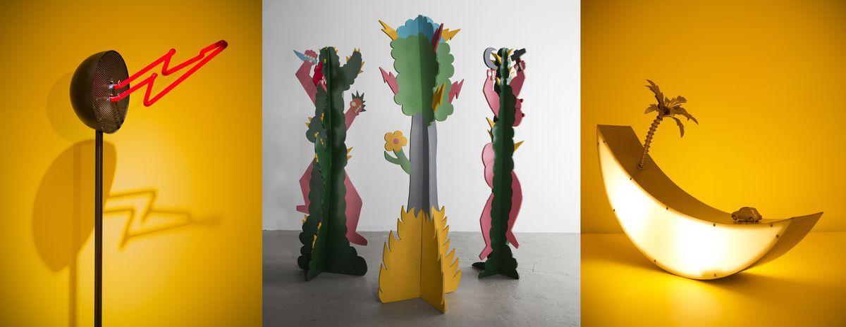 Installation images of lamp with a neon lightning bolt, coat racks that resemble bold colorful cacti, and another lamp in the shape of a moon.