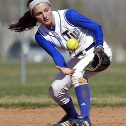 Taylorsville's #2 Karlee Jensen reaches for the ball after it bounced off of her mitt as Taylorsville and Bingham play Tuesday, March 20, 2012 at Taylorsville.