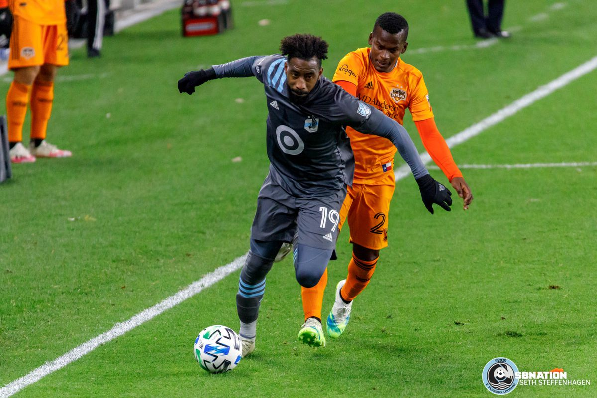 October 18, 2020 - Saint Paul, Minnesota, United States - Minnesota United defender Romain Metanire (19) dribbles the ball as Houston Dynamo forward Darwin Quintero (23) chases during the match at Allianz Field.