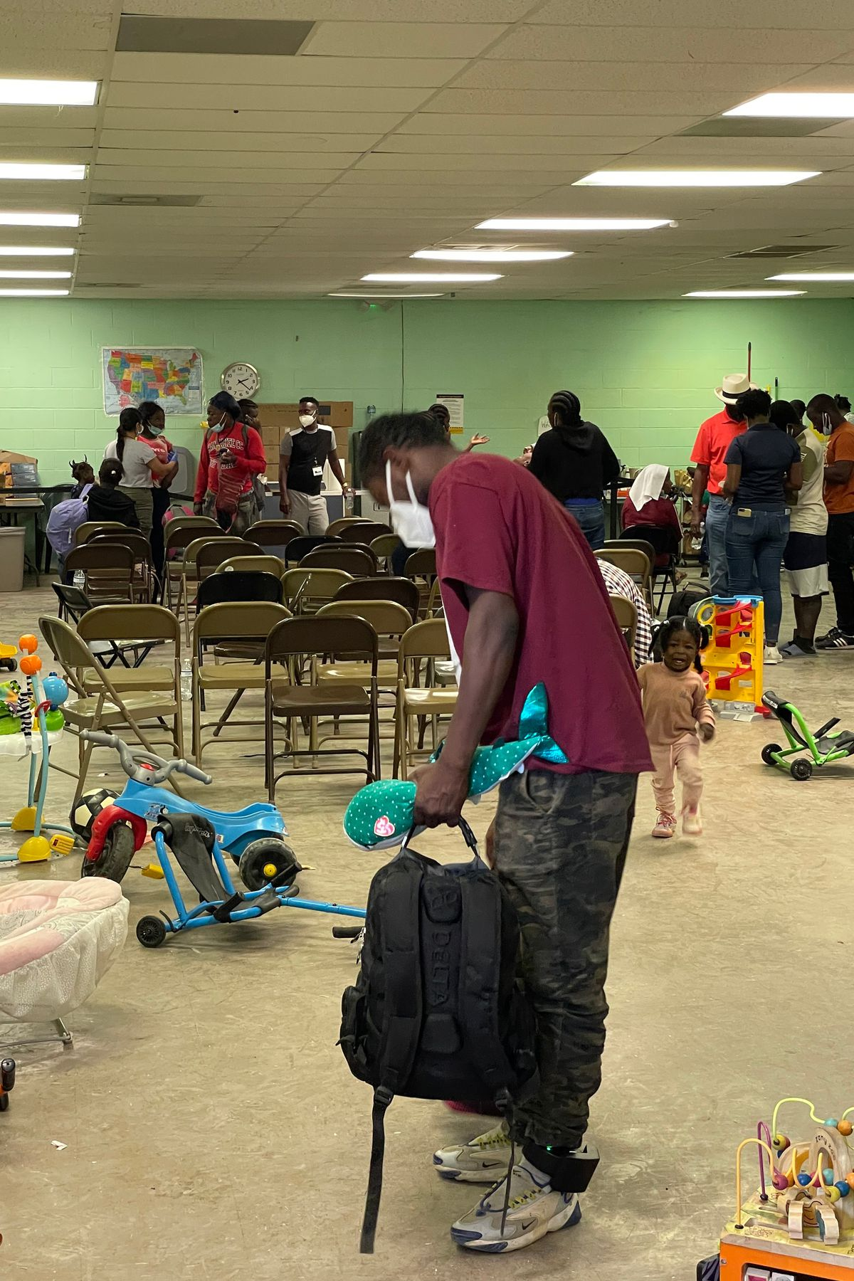 Haitian migrants waited at a processing center in Del Rio, Texas.