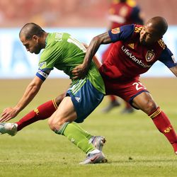 Seattle Sounders midfielder Nicolas Lodeiro (10) battles with Real Salt Lake midfielder Everton Luiz (25) for the ball as RSL and Seattle Sounders play at Rio Tinto Stadium in Sandy Utah on Wednesday, Aug. 14, 2019.