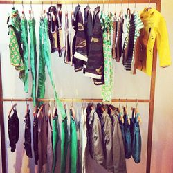 Racks of boys outerwear (hey, camo jacket) and bottoms.