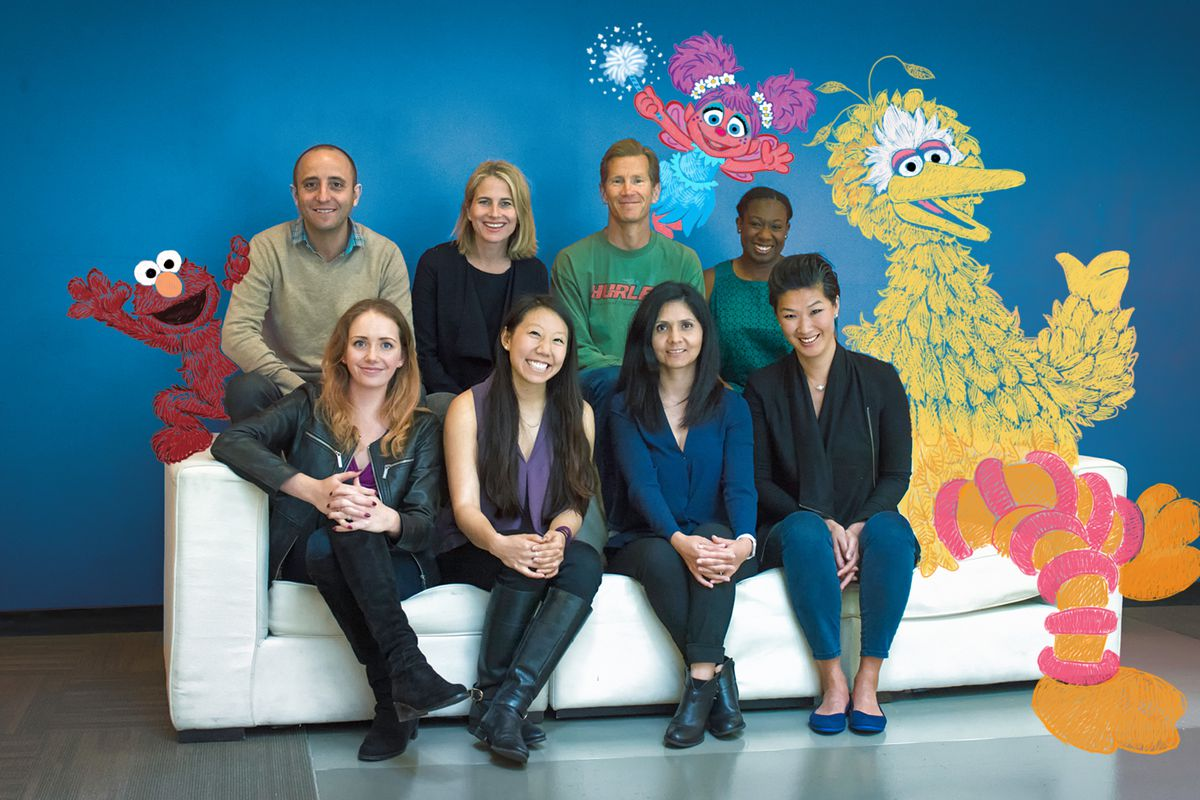 Members of the Reach Capital team along with sketches of Elmo, Big Bird and Abby Cadabby