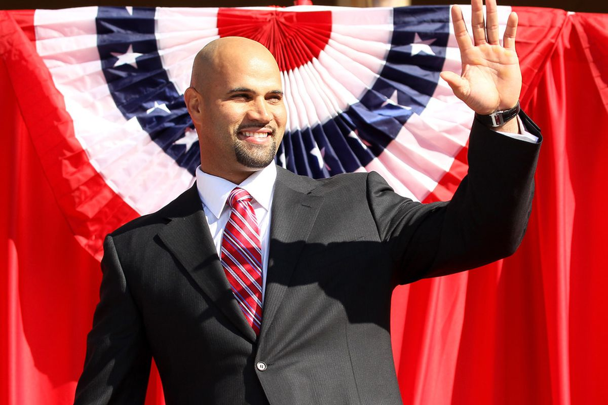 Albert Pujols waves as he takes the stage.  (Photo by Stephen Dunn/Getty Images)