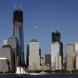 FILE - In this file photo of June 23, 2012, construction cranes perch on top of One World Trade Center, left, and Four World Trade Center in New York. Eleven years after terrorists attacked the World Trade Center, the new World Trade Center now dominates the lower Manhattan skyline.