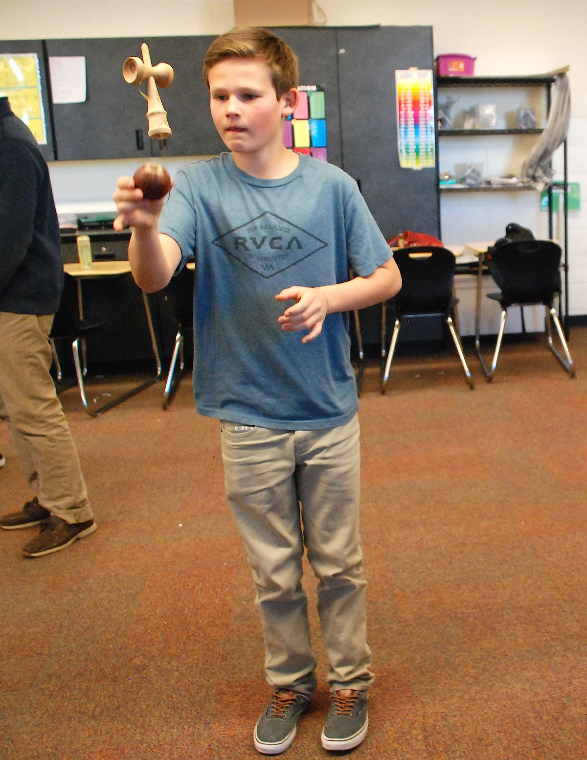 A student practices a trick at a recent meeting of Louisville Middle's Kendama Club.