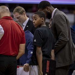 Howard Moore's son Jerrell with the team in the huddle.