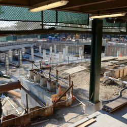 5:52 p.m. A view of the triangle lot/plaza, through the future plaza entrance -