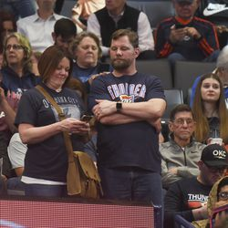 Basketball fans react after it is announced that an NBA basketball game between Oklahoma City Thunder and Utah Jazz in Oklahoma City has been postponed, Wednesday, March 11, 2020.