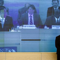 A member of the UN security staff follows the speech of U.N. Secretary-General Ban Ki-moon at the Human Rights Council at the United Nations in Geneva, Switzerland, Monday, Sept. 10, 2012. Ban Ki-moon is urging the world's foremost human rights body to keep up the pressure on major powers to end the civil war in Syria and outbreak of human abuses there.