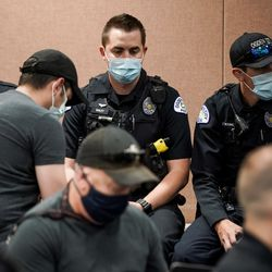 Ogden police officers await the start of a press conference at the Francom Public Safety Center in Ogden about the loss of an officer on Thursday, May 28, 2020.Police said one officer and a suspect were killed, while another officer was injured, in an exchange of gunfire earlier in the day.