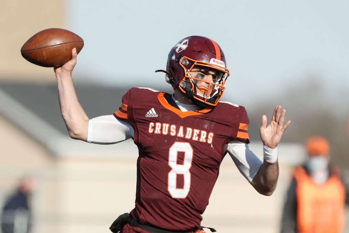 Brother Rice's Jack Lausch (8) passes the ball against Loyola.