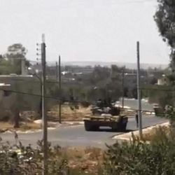 This image made from amateur video provided by Shaam News Network and accessed by the Associated Press on Friday, Sept. 8, 2012 purports to show a Syrian tank in the Tel Chehab area of Daraa, Syria. Activists have reported clashes between troops and rebels in a southern neighbourhood of the capital, Damascus. The Britain-based Syrian Observatory for Human Rights and Local Coordination Committees had no immediate word on casualties from Friday's clashes in Kazaz. The Observatory reported many arrests in the town of Tel Chehab on the border with Jordan, recaptured by troops Thursday.