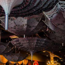 Umbrellas hang over the sex shop