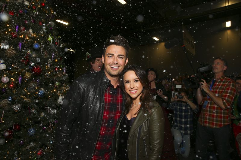 Jonathan Bennett and Lacey Chabert, surrounded by fake snow.