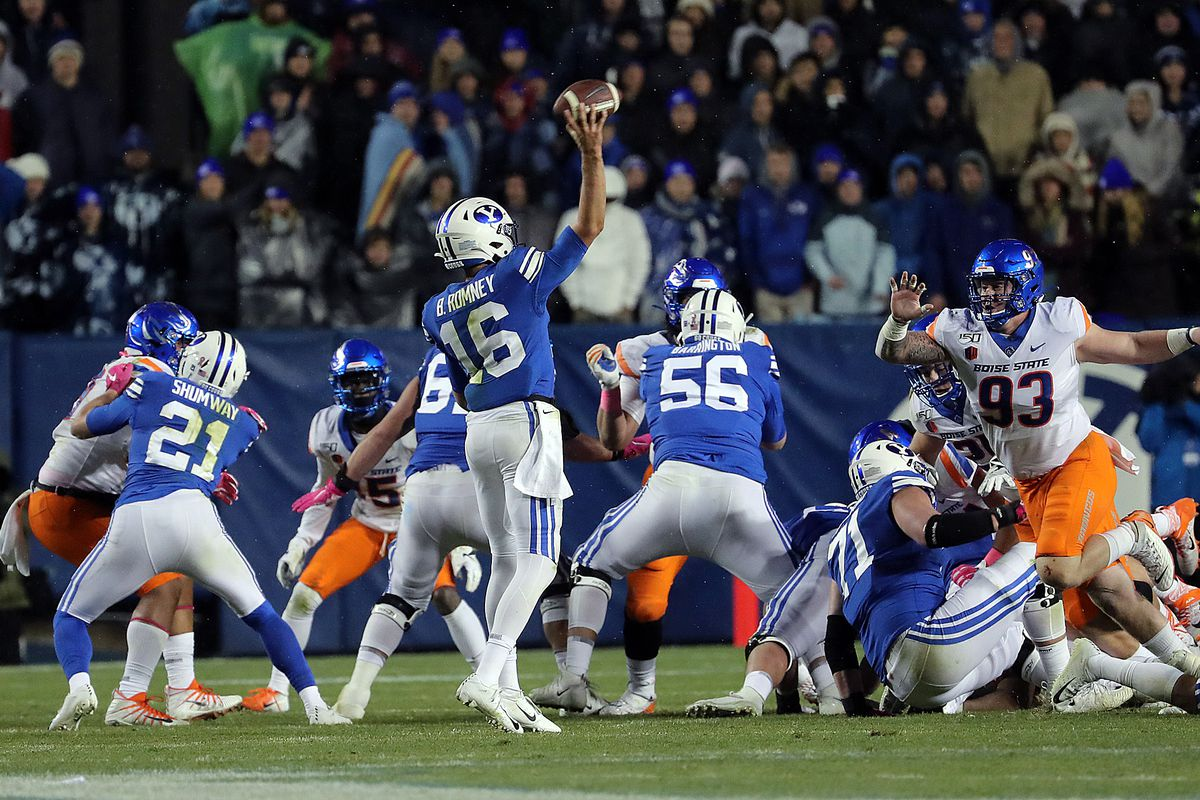 Brigham Young Cougars quarterback Baylor Romney throws a touchdown against the Boise State Broncos during an NCAA football game in Provo on Saturday, Oct. 19, 2019.