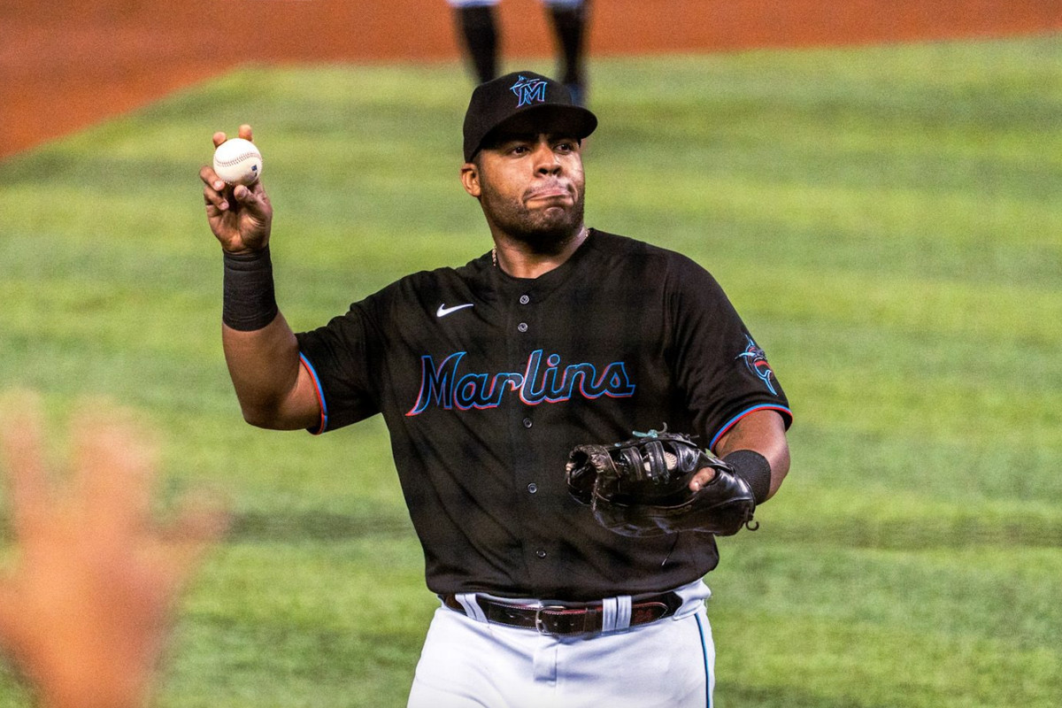 Marlins first baseman Jesús Aguilar prepares to throw a ball into the stands