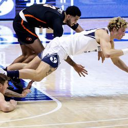 Brigham Young Cougars forward Caleb Lohner (33) passes after scooping up a loose ball during the game against the Pacific Tigers at the Marriott Center in Provo on Saturday, Jan. 30, 2021.