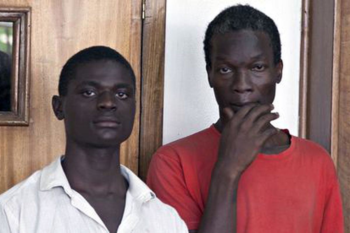 Jackson Mukasa, left, and Kim Mukasa, right, in court in Uganda charged with engaging in sex.