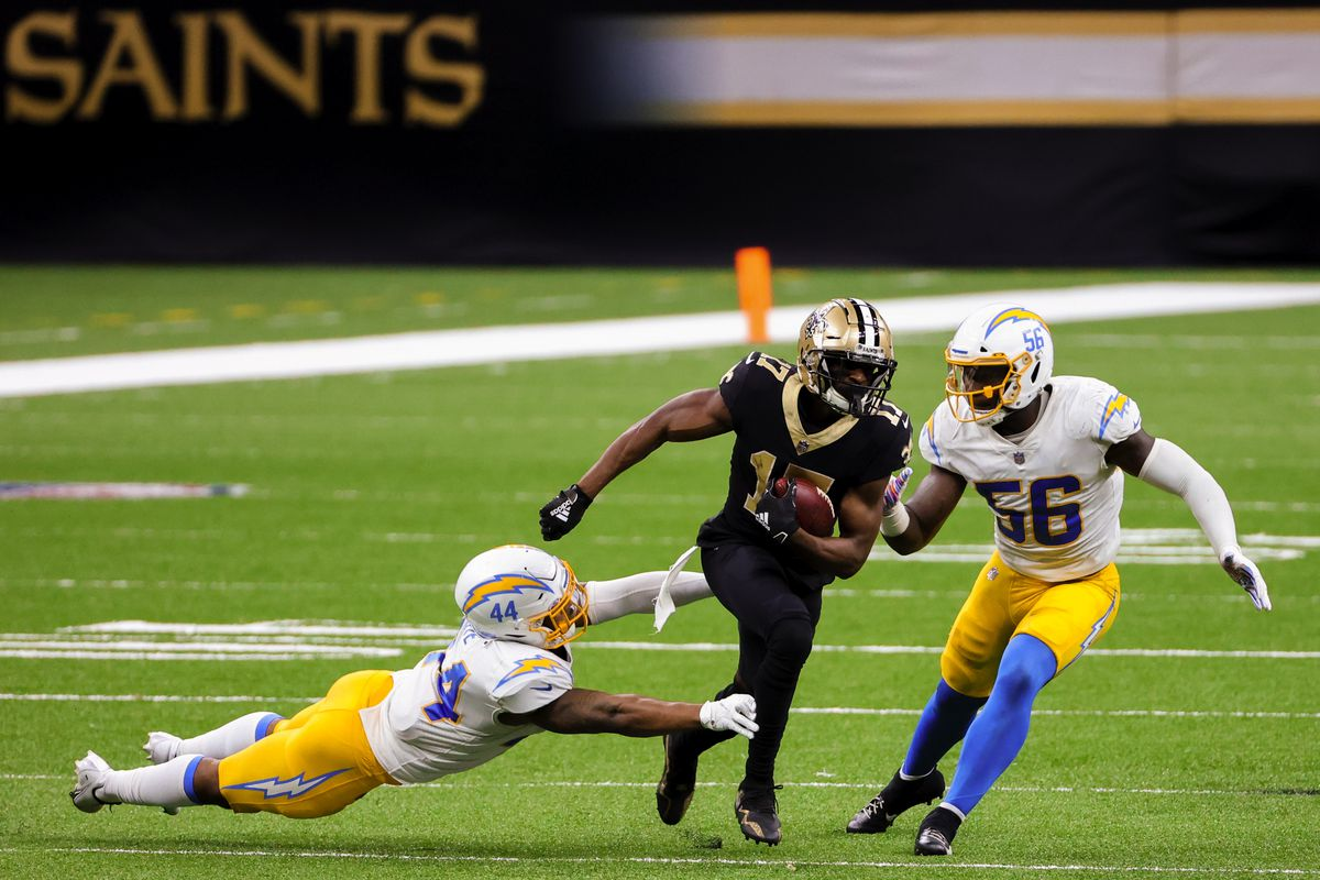 New Orleans Saints wide receiver Emmanuel Sanders (17) runs past Los Angeles Chargers linebacker Kyzir White (44) and linebacker Kenneth Murray Jr. (56) during the second half at the Mercedes-Benz Superdome.