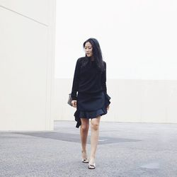 """Ann of <a href=""""http://www.andyheart.com""""target=""""_blank"""">Andy Heart</a> is wearing a J.W. Anderson skirt, Celine sandals and purse and an <a href=""""http://www.net-a-porter.com/product/377272?cm_sp=we_recommend-_-377272-_-slot1&cm_mmc=LinkshareUS-_-QFGLnEol"""