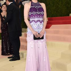 Emma Roberts wears a Tory Burch gown.