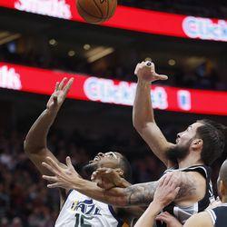 Utah Jazz forward Derrick Favors (15) and San Antonio Spurs center Joffrey Lauvergne (77) fight for the ball in Salt Lake City on Thursday, Dec. 21, 2017. Utah won 100-89.