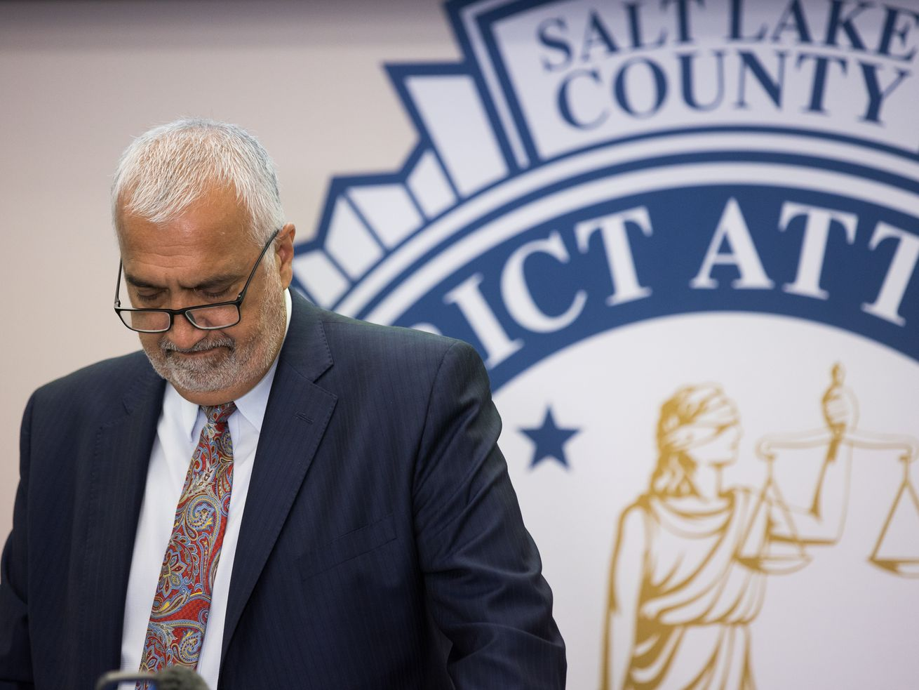 Salt Lake County District Attorney Sim Gill briefs journalists at the District Attorney's Office building in Salt Lake City.