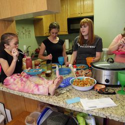 BYU student Kelsey Morasco eats with roommates Ashley Mauger, Lindsey Hunt and Breanna Hutchings in their apartment in Provo April 29, 2012.