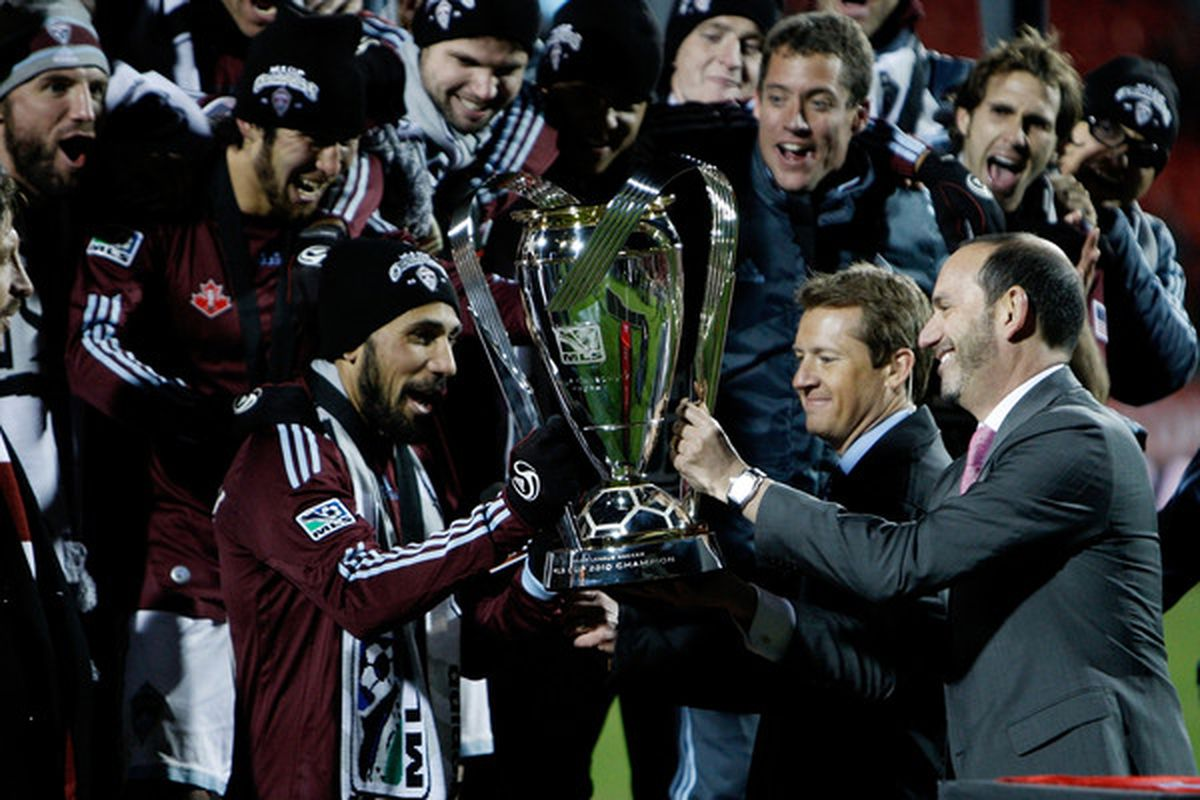 TORONTO ON - NOVEMBER 21:  MLS Commissioner Don Garber (R) hands the Philip F. Anschutz Trophy to Captain Pablo Mastroeni #25 (L) of the Colorado Rapids (Photo by Abelimages/Getty Images)