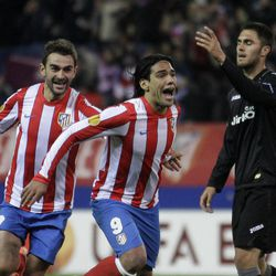 Atletico de Madrid's Radamel Falcao of Colombia, centre celebrates with Adrian Lopez, left after scoring against Valencia during the first leg Europa League semifinal soccer match at the Vicente Calderon stadium in Madrid Thursday April 19, 2012. Atletico de Madrid won the match 4-2.